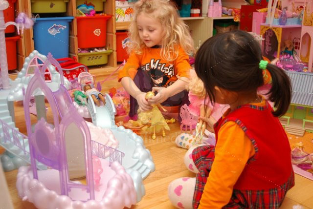 children playing with Barbie dolls