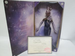 2002 Sterling Silver Rose™ Barbie® Doll AA inside