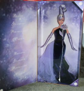 2002 Sterling Silver Rose™ Barbie® Doll H inside