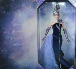 2002 Sterling Silver Rose™ Barbie® Doll insside